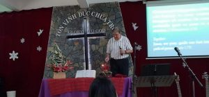 Ron (representing USA) lighting the Second Advent Candle during ICF Christmas Service
